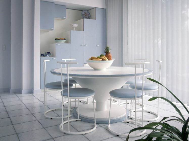 Modern Dining Room with Staggered Cabinets and Vertical Blinds